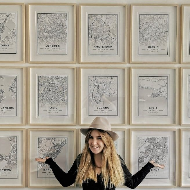 ivana bonjolo standing in front of her Mapiful gallery wall