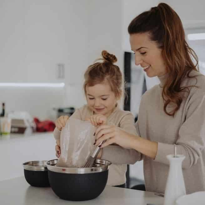 girl and her mother baking